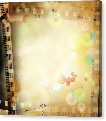 Film Frames  Canvas Print by Les Cunliffe