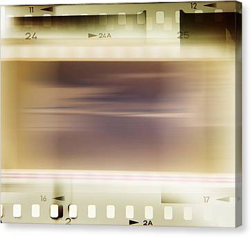 Film Strips Canvas Print by Les Cunliffe