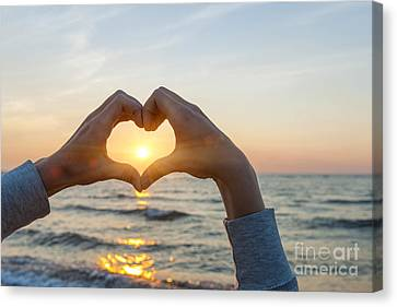 Fingers Heart Framing Ocean Sunset Canvas Print