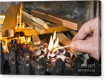 Fire Being Lit Canvas Print by Martyn F. Chillmaid