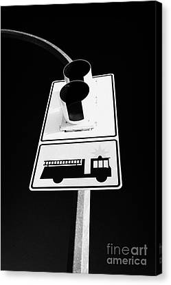 fire engine stop sign and signal Saskatoon Saskatchewan Canada Canvas Print by Joe Fox