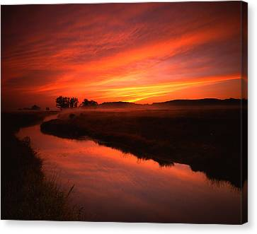 Fire In The Sky Canvas Print by Ray Mathis
