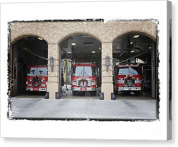 Fire Trucks At The Lafd Fire Station Are Decorated For Christmas Canvas Print by Nina Prommer