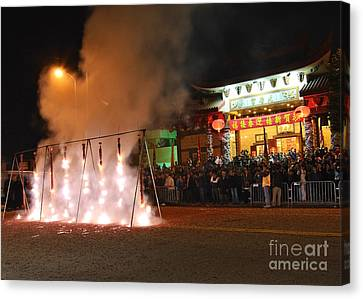 Firecrackers At Night During The Chinese New Years Celebration. Canvas Print by Jamie Pham