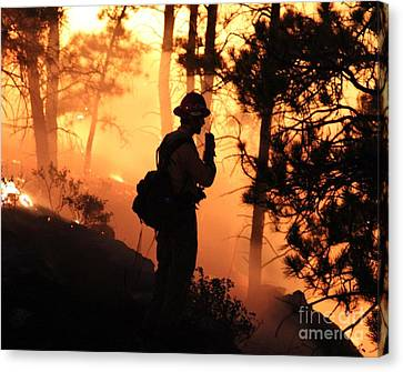 Firefighter At Night On The White Draw Fire Canvas Print by Bill Gabbert