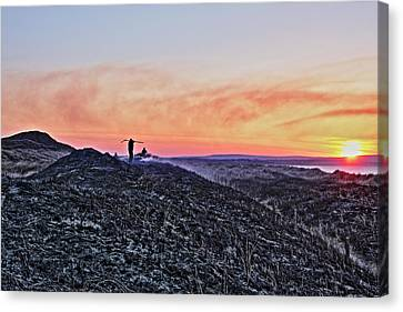 Firefighter At Sunset Canvas Print by Tony Reddington