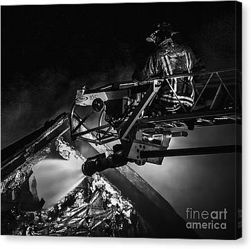 Firefighter At Work Canvas Print by Jim Lepard
