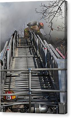 Firefighter On Telescopic Ladder Canvas Print by Jim West