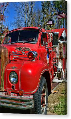 Fireman - A Very Old Fire Truck Canvas Print by Paul Ward