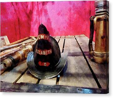 Fireman - Fire Helmet In Fire Truck Canvas Print by Susan Savad