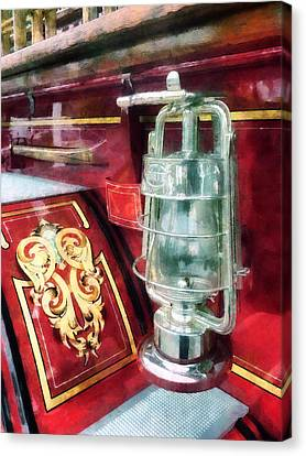 Fireman - Lantern On Old Fire Truck Canvas Print by Susan Savad
