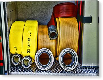 Fireman - The Fire Hose Canvas Print by Paul Ward