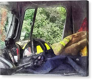 Firemen - Helmet Inside Cab Of Fire Truck Canvas Print by Susan Savad