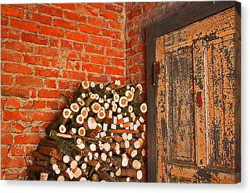 Firewood And Door Canvas Print by Bobby Villapando