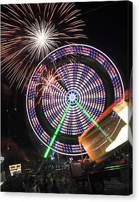Fireworks Bursting Over A Ferris Wheel Carnival Ride Canvas Print