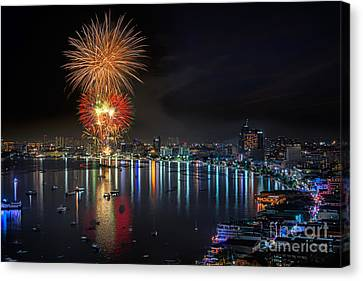 Fireworks New Year Celebration At Pattaya Beach Canvas Print by Anek Suwannaphoom