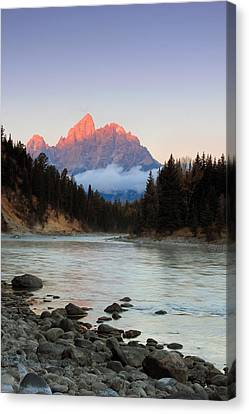 First Light On The Grand Teton Canvas Print by Johnny Adolphson