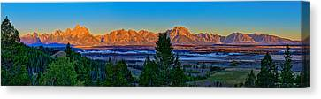 First Light On The Tetons Canvas Print by Greg Norrell