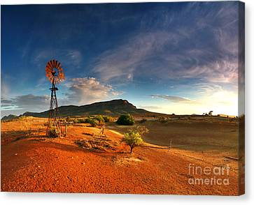 Red Skies Canvas Print - First Light On Wilpena Pound by Bill  Robinson