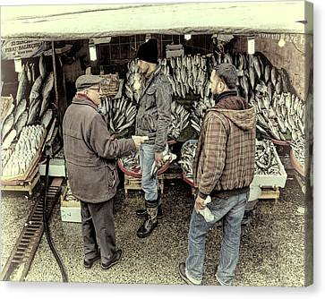 Fish Market Transaction Canvas Print by Joan Carroll