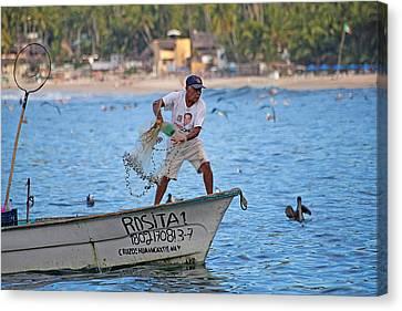 Fisher Man Throwing Net Canvas Print by Camilla Fuchs