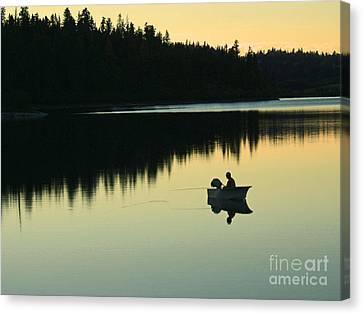 Fisherman At Dusk Canvas Print by Nancy Harrison