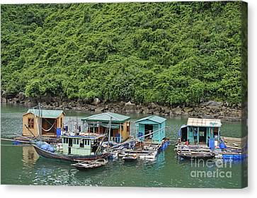 Fisherman Floatting Houses Canvas Print by Sami Sarkis
