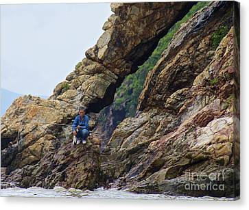 Canvas Print featuring the photograph Fisherman On Rocks  by Sarah Mullin