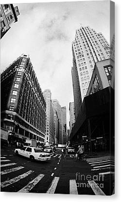 Manhatten Canvas Print - Fisheye Shot Of Yellow Cab On Intersection Of Broadway And 35th Street At Herald Square New York by Joe Fox