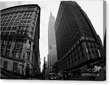 fisheye shot View of the empire state building from West 34th Street and Broadway new york city Canvas Print by Joe Fox