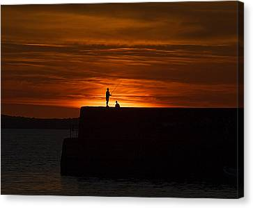 Fishing As Sunset Canvas Print by Tony Reddington