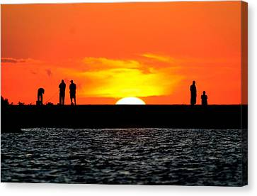Fishing At Sunset Canvas Print by Michael Allen