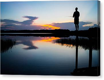 Fishing At Sunset Canvas Print by Parker Cunningham