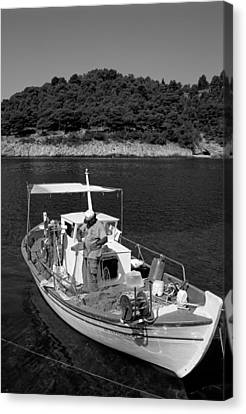 Fishing Boat In Asos Village Canvas Print by George Atsametakis