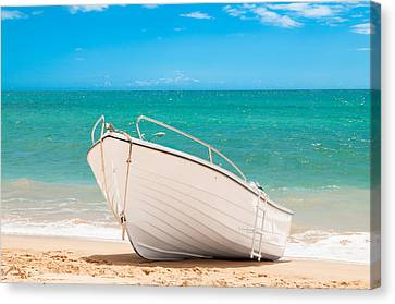 Fishing Boat On The Beach Algarve Portugal Canvas Print by Amanda Elwell