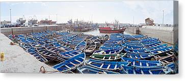 Fishing Boats Moored At A Dock Canvas Print by Panoramic Images