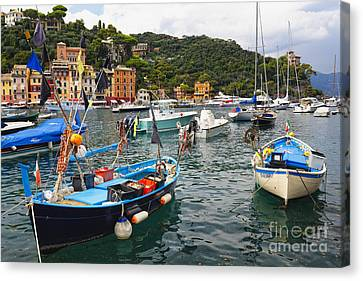 Fishing Boats Of Portofino Canvas Print by George Oze