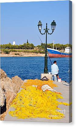 Fishing In Spetses Town Canvas Print by George Atsametakis