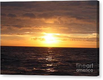 Reflection Of Sun In Clouds Canvas Print - Fishing Into The Sunrise by John Telfer