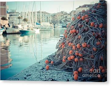 Fishing Net Canvas Print by Hannes Cmarits