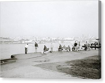 Fishing On The Golden Horn Canvas Print by Shaun Higson