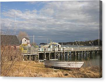 Fishing Pier And Rowboat In Tenants Harbor Maine Canvas Print by Keith Webber Jr