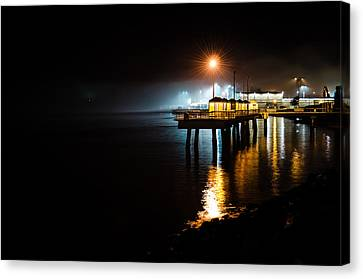 Fishing Pier At Night Canvas Print by Brian Xavier