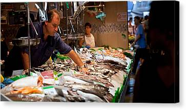 Fishmonger At A Fish Stall, La Boqueria Canvas Print by Panoramic Images