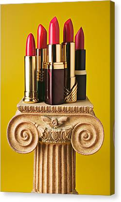 Five Red Lipstick Tubes On Pedestal Canvas Print by Garry Gay