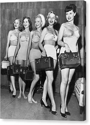 Five Women Pose With Bags Canvas Print by Underwood Archives