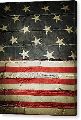 Flag On Wall Canvas Print by Les Cunliffe