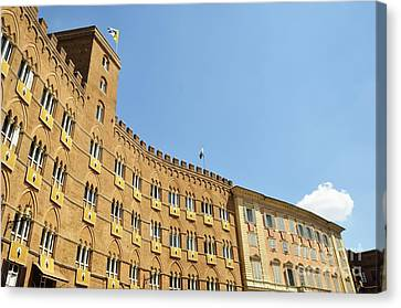 Flags On Building On Piazza Del Campo Canvas Print by Sami Sarkis