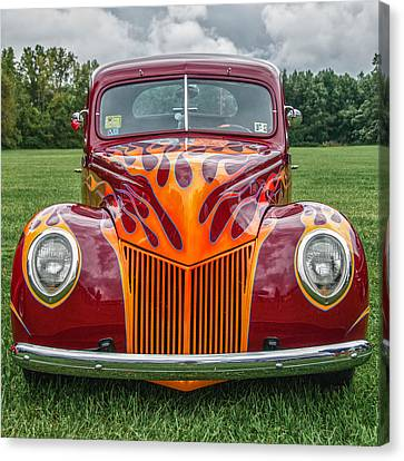 Flames Canvas Print by Guy Whiteley