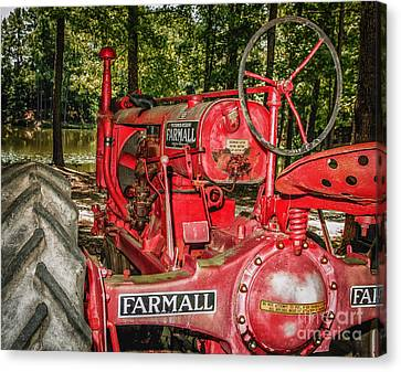Flash On Farmall Canvas Print by Robert Frederick